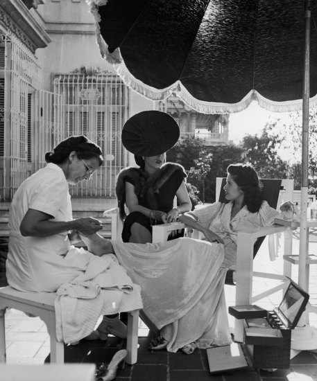 Subject: Cuban Socialite Aline Johnson and friend Nina Gomez de Freyre receiving manicures. Havana, Cuba 1946 Photographer- Nina Leen Time Inc Owned Merlin-1153824