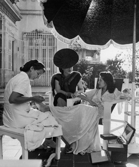 Subject: Cuban Socialite Aline Johnson and friend Nina Gomez de Freyre receiving manicures. Havana, Cuba 1946 Photographer- Nina Leen Time Inc Owned Merlin-1153824