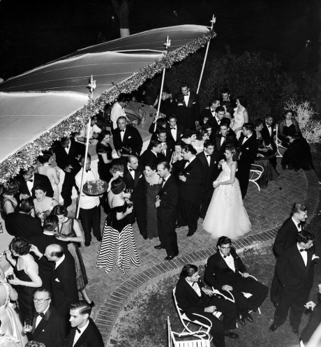 Subject: Outdoor party with silk canopies for socialites attending parties of Cuba's first lady La condesa de Comargo. Havan, Cuba 1950 Photographer- Eliot Elisofon Time Inc Owned merlin- 1199920